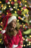 Girl with christmas hat on black Royalty Free Stock Photography