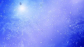 Girl in Christmas hat blowing flying snowflake on blue snow background. stock footage