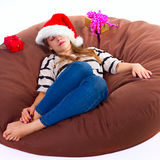 Girl in Christmas hat . the brown chair Stock Image