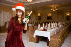 Girl in a Christmas hat with champagne Stock Photography