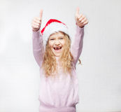 Girl in christmas hat. Child in christmas hat on white background. Happy little girl Stock Images
