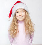 Girl in christmas hat. Child in christmas hat on white background. Happy little girl Royalty Free Stock Photo