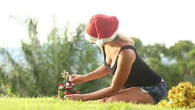 Girl in a Christmas hat decoration with bells a Christmas stock footage