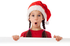 Girl in Christmas hat with empty banner Royalty Free Stock Image