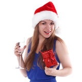 Girl in Christmas hat with  gift and glass of champagne Stock Photos
