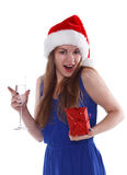 Girl in Christmas hat with  gift and glass of champagne Royalty Free Stock Photos