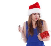 Girl in Christmas hat with  gift and glass of champagne Stock Image