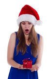 Girl in Christmas hat gift upset. On a white background Stock Image