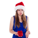Girl in Christmas hat gift upset. On a white background Royalty Free Stock Photography