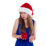 Girl in Christmas hat gift upset. On a white background Stock Images