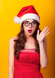 Girl in christmas hat with gifts royalty free stock image