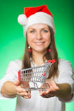 Girl in a Christmas hat on a green background Stock Photo