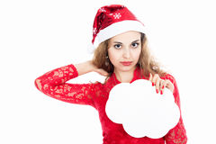 Girl in a Christmas hat holding banners in the form of clouds Stock Photo