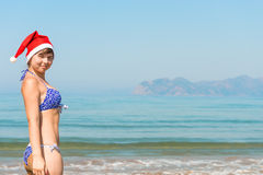 Girl in a Christmas hat on holiday Royalty Free Stock Photos