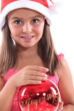 Girl with Christmas hat Stock Photography