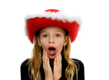 Girl with christmas hat lookes amazed Royalty Free Stock Image