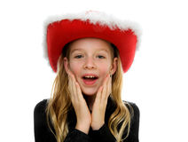 Girl with christmas hat looks surprised Royalty Free Stock Images