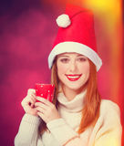 Girl in christmas hat Royalty Free Stock Photography