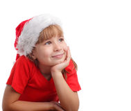 Girl in a Christmas hat thinking Stock Images