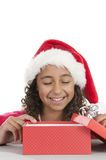 Girl with christmas hat on white Royalty Free Stock Images