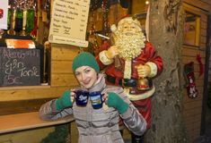 Girl in the Christmas market holding mugs with mulled wine. Luxemburg Stock Photography