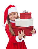 Girl in christmas outfit holding presents Stock Photography