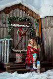 Girl about Christmas porch covered with a heated blanket. New year Royalty Free Stock Images