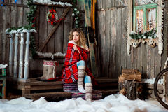 Girl about Christmas porch covered with a heated blanket. New year Royalty Free Stock Image