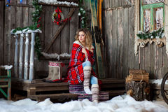 Girl about Christmas porch covered with a heated blanket. New year Stock Photo