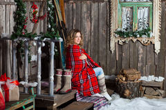 Girl about Christmas porch covered with a heated blanket. New year Stock Photos