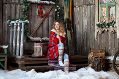 Girl about Christmas porch covered with a heated blanket. New year Stock Images