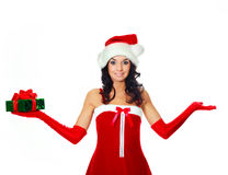 Girl with a Christmas present Royalty Free Stock Images
