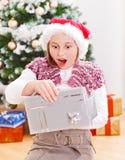 Girl with Christmas present Stock Photos