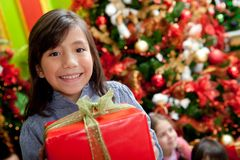 Girl with a Christmas present Stock Images