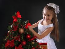 Girl with christmas present Royalty Free Stock Photos