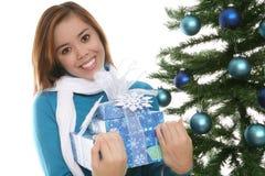 Girl with Christmas present Stock Image