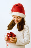Girl with christmas present Stock Image