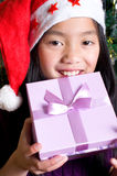 Girl with a christmas present Royalty Free Stock Photo