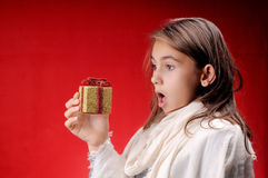 Girl with Christmas present Royalty Free Stock Photography
