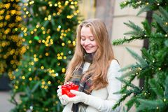 Girl with a Christmas present Stock Photos