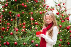 Girl with a Christmas present Stock Image