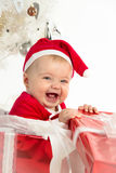 Girl in a christmas present Royalty Free Stock Photography