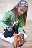 Girl and Christmas presents Royalty Free Stock Photos