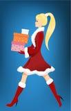 Girl with Christmas presents Stock Photos