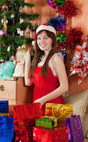 Girl with christmas presents Royalty Free Stock Images
