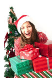 Girl with Christmas presents Stock Images