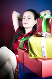 Girl and Christmas presents Royalty Free Stock Image