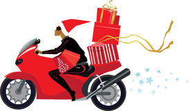 Girl with christmas presents on a motorcycle Stock Photo