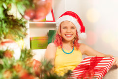 Girl with Christmas presents view through NY tree Royalty Free Stock Image