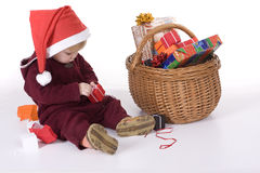 Girl in christmas red hat with gift boxes Royalty Free Stock Image